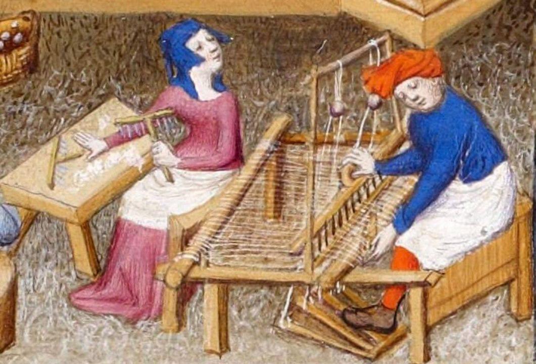 Questa miniatura medievale potrebbe intitolarsi: Susanna mentre carda la lana guarda amorevolmente il figlioletto Cristoforo impegnato al telaio.